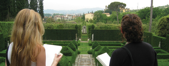 Tuscany, two girls drawing in a beautifully manicured garden