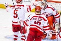 Frozen Four, here we come! Terriers Matt Grzelcyk (COM'16), Danny O'Regan (COM'16), and Doyle Somerby (CGS'15) converge on goalie Matt O'Connor (SMG'16) after BU's 3-2 win over Minnesota Duluth in Saturday's NCAA Northeast Regional final in Manchester, N.H. The Terriers are on their way to the NCAA championship at Boston's TD Garden April 9 and 11. Photo by Brian Kelley/BU Athletics