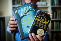 Boston University professor John T. Matthews holding copies of the books Go Set a Watchman and To Kill a Mockingbird by Harper Lee