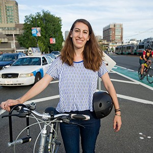 Carly Sitrin (COM'17)  talking bike safety on Commonwealth Ave Boston
