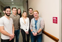 The six Questrom students who got the restrooms' designation changed are Benji Hadar (Questrom'16) (from left), Alex Paroda (Questrom'16), India Mazzarelli (Questrom'17), Halle Gecawich (Questrom'16), Zach Cracknell (Questrom'16), and Zack Robinson  (Questrom'16). Photo by Dana J. Quigley