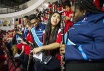 The BU Pep Band and Boston English High School Marching Band perform at the December 5 men's hockey game at Agganis Arena: BEHS students Duel Vernet (left) and Jasmin Robinson (right) and Emily Raymond (CFA'19). Photo by Cydney Scott