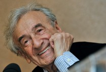 Elie Wiesel smiles during a news conference in Budapest, Hungary.