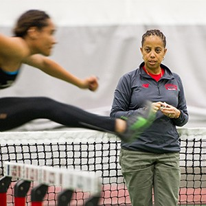 Robyne Johnson, track and field director at Boston University, watches track team members do hurdles during a team practice