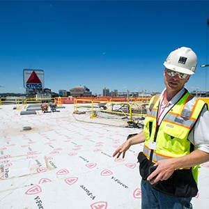 Al Hartshorn, Shawmut Design and Construction senior project superintendent, stabds on Myles Standish Hall new roof