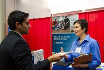 A student speaking with a host a the BU's Center for Career Development career fair