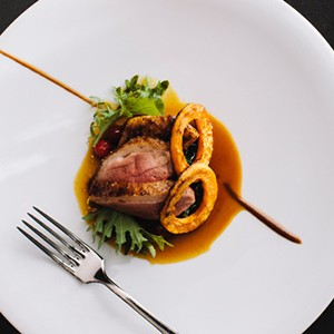 photo of duck breast and squash rings on a plate
