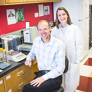 Mark Grinstaff and Marlena Konieczynska pose for a photo in their lab