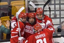 BU Terriers men's ice hockey players celebrate after scoring a goal during the 65th Annual Men's Beanpot Tournament
