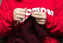 A student member of the BU Knitting Club, a Boston University club open to all students who crochet, weave, spin, or do embroidery