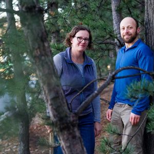 Photo of Lucy Hutyra and Andrew Reinmann in the forest
