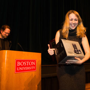 Emily Sheehan won the Redstone Film Festival award for best picture from festival faculty director Geoffrey Poister, a COM associate professor of film and television.