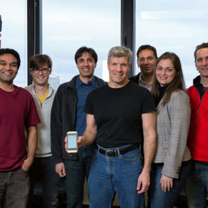 Biomedical Engineering Professor Edward Damiano in his lab with fellow researchers and their bionic pancreas