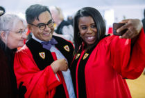 Orange is the New Black cast member Uzo Aduba takes a photo with students at the Boston University College of Fine Arts convocation, part of the 144th BU Commencement