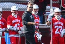 Head Coach Ryan Polley coaches from the sidelines during a BU Terriers lacrosse game