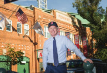 Professor Tom Whalen poses for a photo in front of Fenway Park