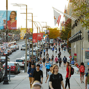 Students walk along Commonwealth Ave. on the Boston University Charles River Campus