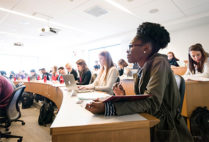 Students follow along during a class at the Boston University School of Law