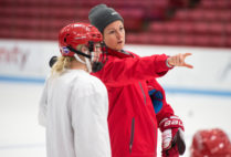 BU Ice Hockey Coach Tara Watchorn instructs a player during practice.