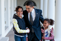 Photograph taken by official White House photographer Pete Souza of President Barack Obama with daughers Malia and Sasha outside the Oval Office