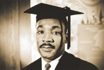 Portrait of Martin Luther King Jr, in a graduation robe and mortarboard hat upon receiving an honorary degree from Boston University in 1958