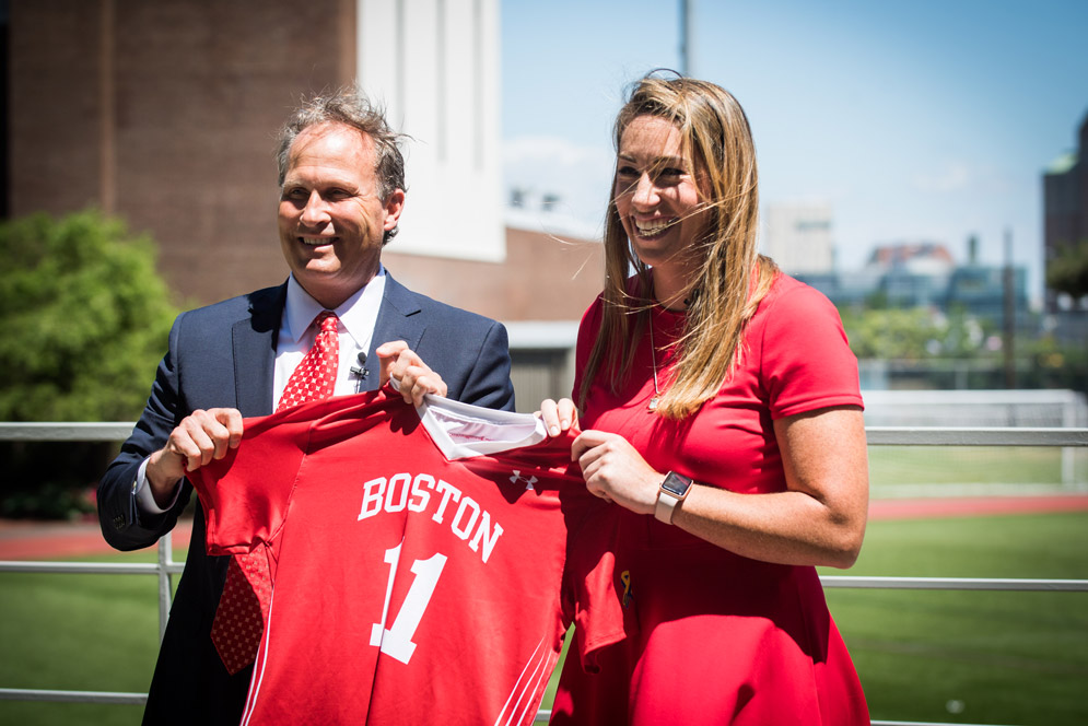 Drew Marrochello, BU athletics director, welcomed Lauren Morton (CAS'08) as BU's new women's lacrosse coach with a jersey featuring her number from her University playing days. Photo by Jackie Ricciardi