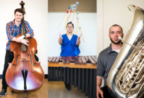 BU music students pose with the oversized instruments they play.