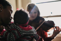 Congolese immigrant Shana (left) worked with CFA alums in the chamber group Palaver Strings—led by violinist Maya French (CFA'15,'18) (right)—to write a lullaby for her baby girl.