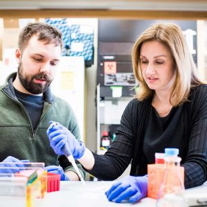 Catherine Klapperich, here with PhD candidate Justin Rosenbohm (ENG'20) in her lab. Photo by Jackie Ricciardi