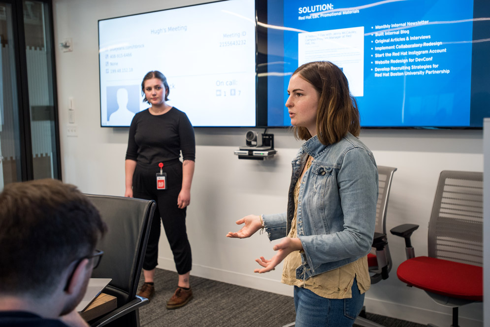 Grace Colbert (CFA'19) (left) and Fiona Whittington (COM'19) talk about projects in progress to fellow interns and Red Hat staff at a lunchtime series at the company's offices in the Seaport District.