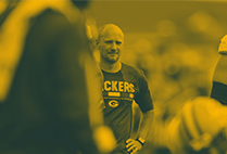 Sports dietitian Adam Korzun on the sidelines during a Green Bay Packers game.