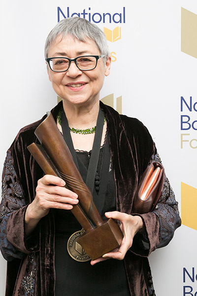 Sigrid Nunez poses for a photo holding her National Book Award.