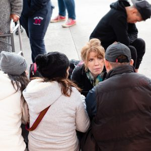 Karen Pita Loor, a School of Law clinical associate professor of law, talks to Central American migrants in Tijuana, Mexico, about the US asylum process, during a recent trip by LAW faculty and students to the border.