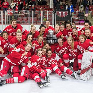 The BU women's ice hockey team poses with the Beanpot Trophy after winning the 41st Annual Beanpot Tournament Championship.