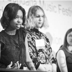 BU entrepreneurs Ellice Patterson, Dielle Lundberg, and Inês Andrade answer questions at the podium during the IDEA 2019 conference.