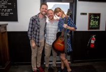 Taylor swift poses with the happy couple