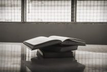 Stack of books on a table in a prison