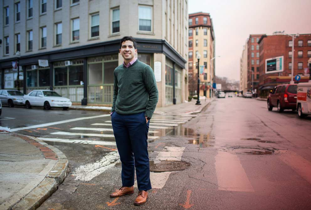 Massachusetts House of Representatives Andy Vargas smiles for a portrait taken in the empty streets of a Boston neighborhood.