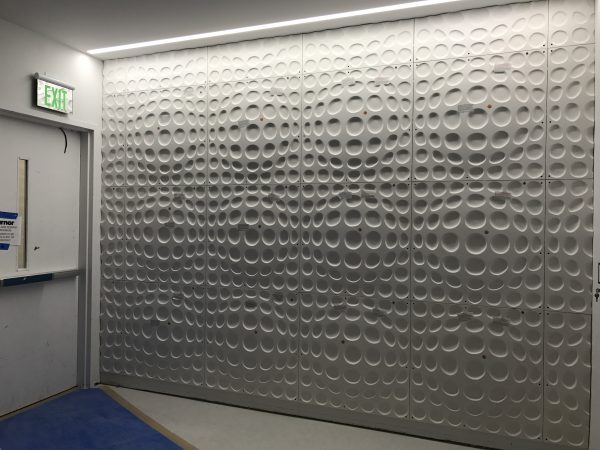 Decorative Wall Panels Installed in West Elevator Lobbies Floors 4-9