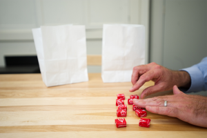 experiment used by Boston University psychology professor Peter Blake where children were given 10 Starburst candies and asked them divide the candies into two bags, one to keep and one to give away