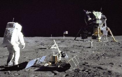 Apollo 11 astronaut Buzz Aldrin deploys a lunar seismometer.  (Image courtesy NASA)