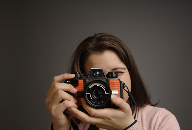Jessica Wurm (COM'08) volunteers in BU photo services department. Photo by Fred Sway