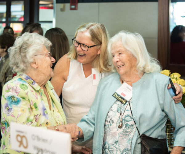 three Sargent alumnae laughing and talking