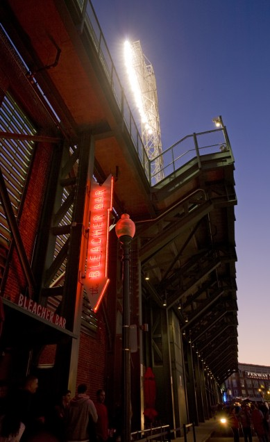 From Lansdowne Street, the glowing Bleacher Bar sign invites fans and tourists in for a unique experience