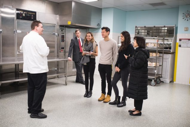 A SHA student team gets a tour of the kitchens at the Boston Convention and Exhibition Center: Tim Elderkin (from left), executive sous chef, Milt Herbert, executive director of the Boston Convention Marketing Center, Julie MacKay, Wei-Chi Victor Su, Sabrina Avila, and Yun-Ting Emily Lai. Photo by Jackie Ricciardi
