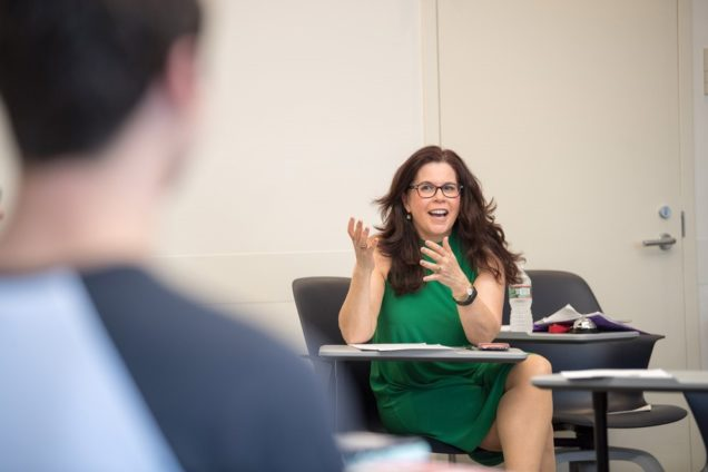 Lively class discussion of student presentations is a trademark of Leora Lanz, an SHA lecturer. Photo by Cydney Scott