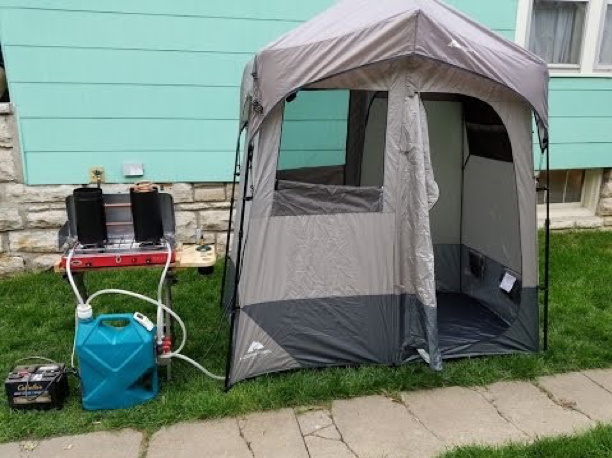 a makeshift shower tent outside