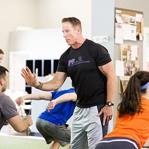 Personal trainer Walter Norton, Jr. working with high school students at Institute of Performance and Fitness
