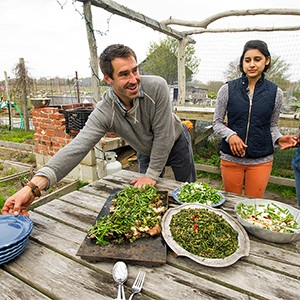 Chris Fischer serves a locally sourced dinner prepared with the help of Boston University Gastronomy students at Beetlebung Farm