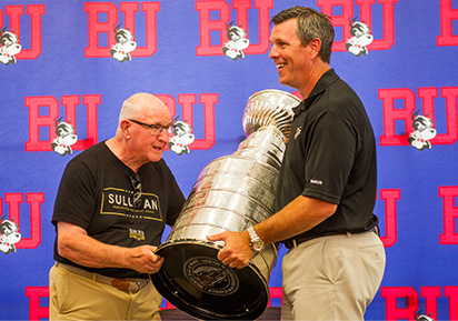 Mike Sullivan holding Stanley Cup with father at BU